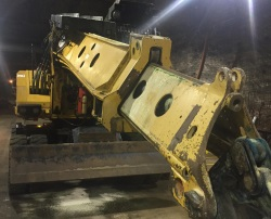 The massive XL5320III Gradall Mechnical Scaler that the underground maintenance workers had to crawl under.